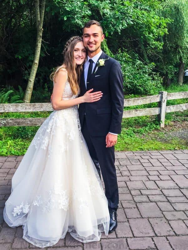 Wedding couple posing with smiles