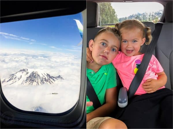 View from airplane window with kids smiling in a car