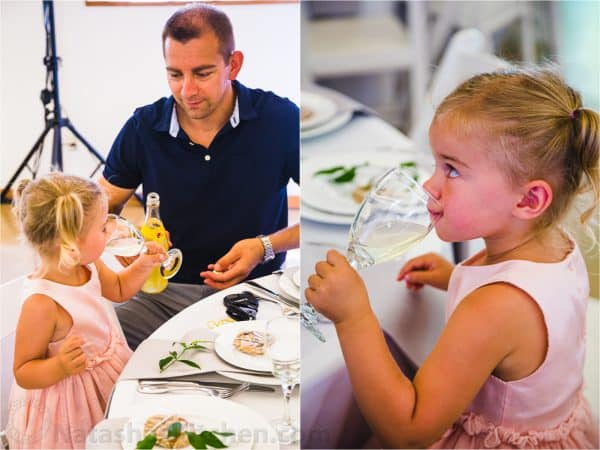 Vadim and daughter drinking juice at wedding