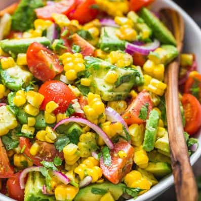 Avocado Corn Salad in a Serving bowl with Spoon