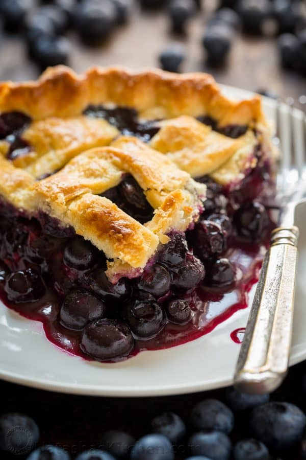 Slice of Blueberry Pie on Plate