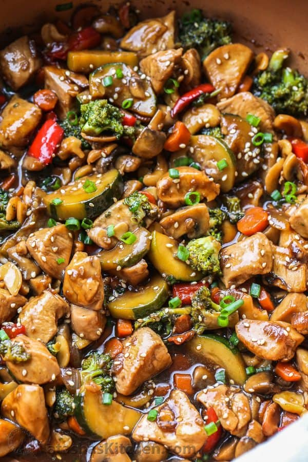 Chicken and vegetables stir fry in a skillet