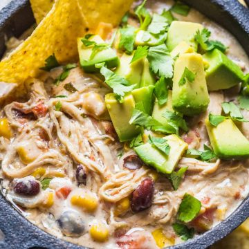 This White Chicken Chili is done in less than an hour start to finish in the Instant Pot with melt-in your mouth tender chicken. Stir everything together in the instant pot, top with cream cheese and set for 20 minutes.
