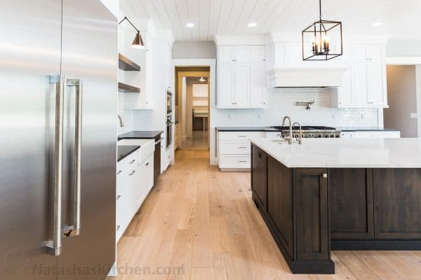 Kitchen walkway with refrigerator