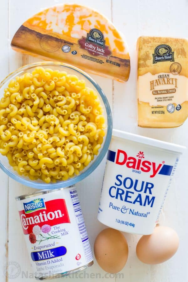 Ingredients for homemade mac and cheese with havarti cheese, colby jack cheese, sour cream and evaporated milk