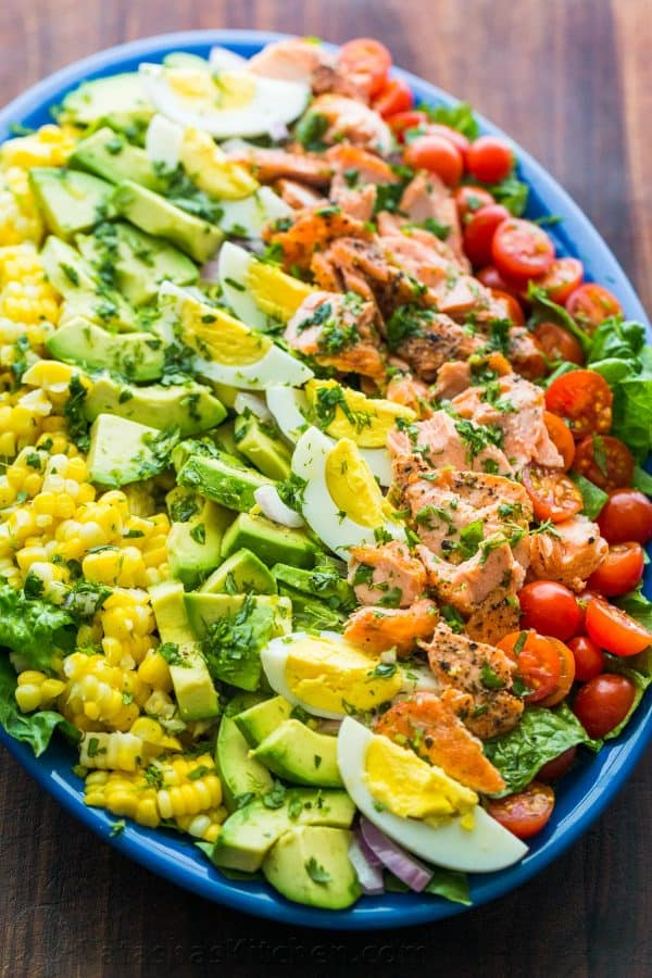 Salmon Cobb Salad served over a bed of lettuce with a zesty cilantro lime dressing