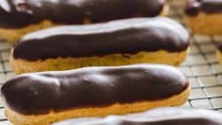 You haven't enjoyed an Eclair until you've tried a fresh homemade eclair! Learn how to make Eclairs with choux pastry, pastry cream and chocolate ganache. | natashaskitchen.com