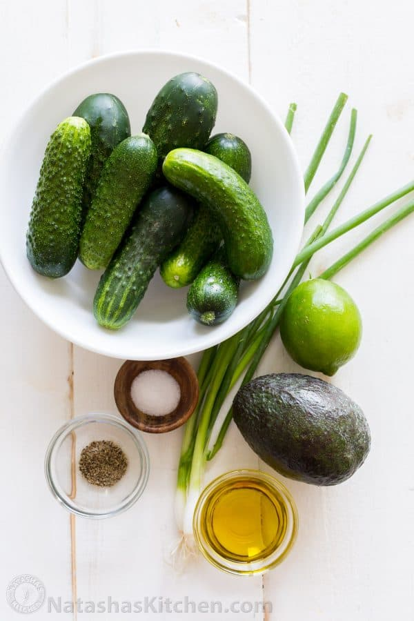 Ingredients for cucumber salad with avocado, green onion, lime juice
