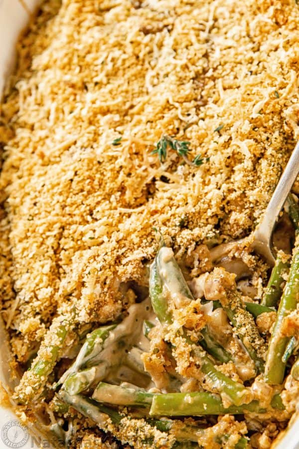 How to make green bean casserole with close-up of Green Bean Casserole with a spoon