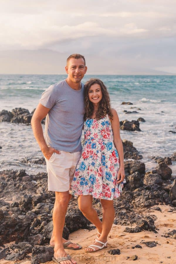 A couple standing on a rocky beach
