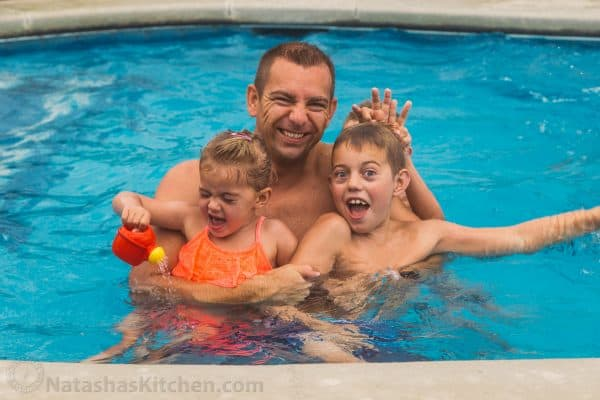A father and two children in a pool