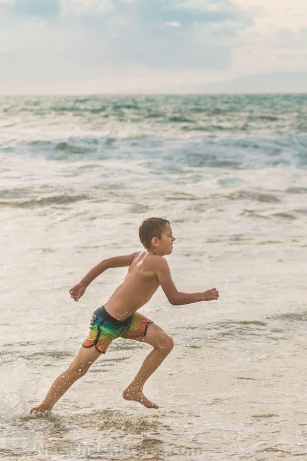A boy running at the beach