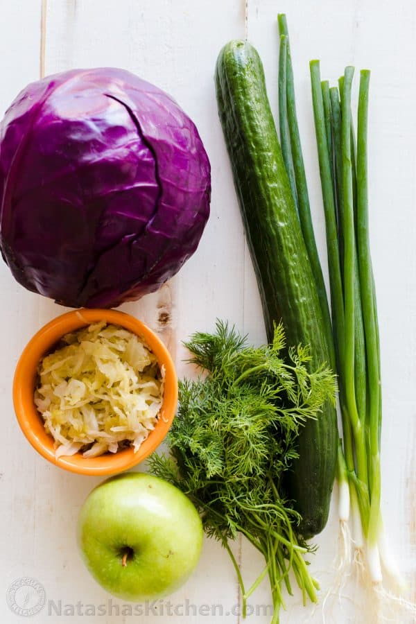 Ingredients for Red Cabbage Salad with Purple Cabbage, cucumber Granny smith apple, green onion, sauerkraut, dill and green onion