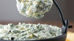 This Spinach Artichoke Dip recipe is too easy; pretty much heating and mixing. This dip is irresistibly creamy and every bite is loaded with spinach and artichokes. #spinachartichokedip #spinachandartichokedip #spinachdip #artichokedip #partydip #dip #appetizer