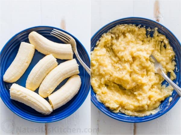 Mashing peeled overripe ripe bananas in a blue bowl