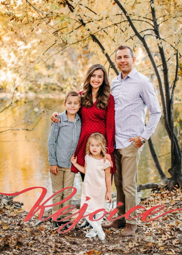 A Christmas card of a family that says Rejoice