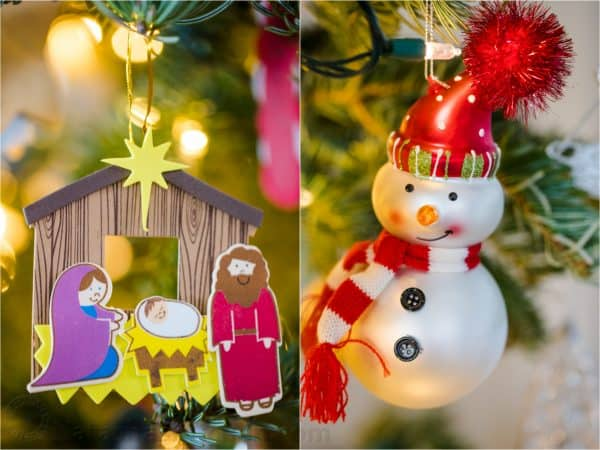 A close up of two ornaments, one of Jesus in a manger and another of snowman