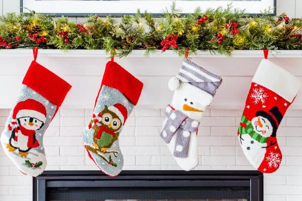 A close up of four Christmas stockings