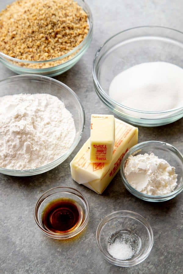 Ingredients for baci di dama Italian cakes with hazelnuts, butter and flour