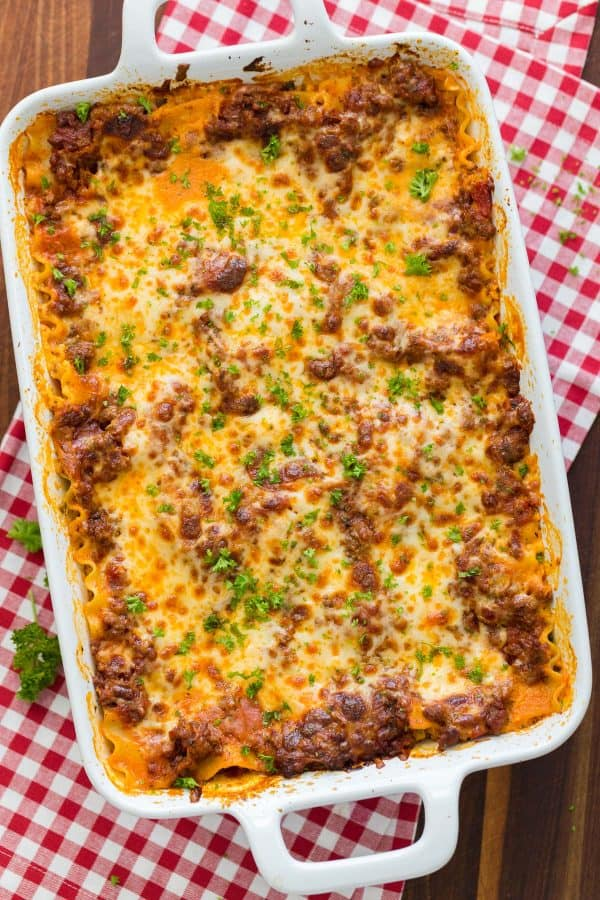Easy lasagna recipe baked in casserole and garnished with parsley
