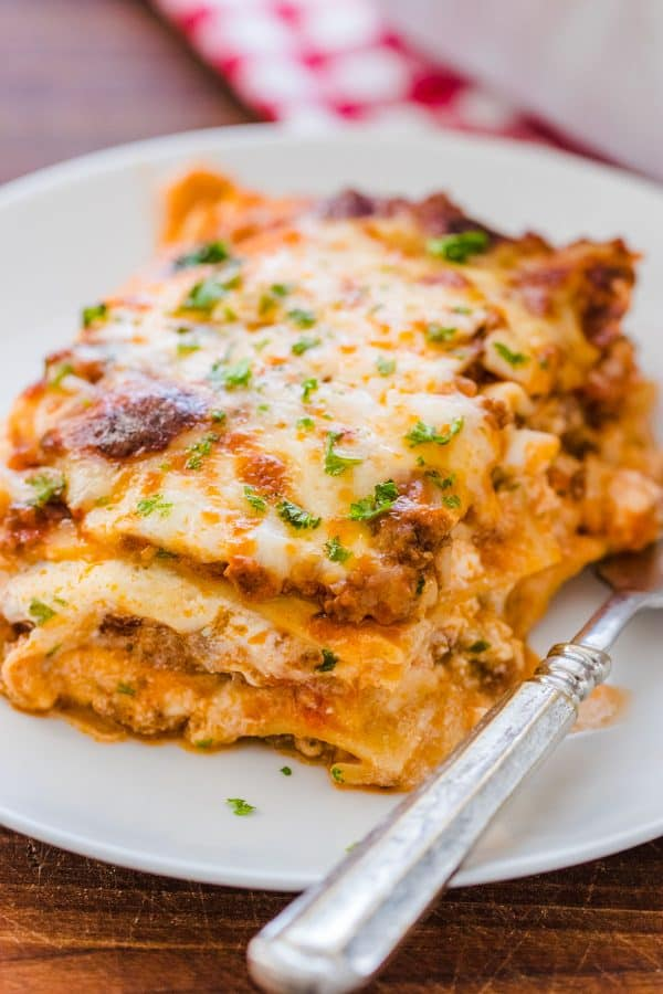 Slice of Italian Style Lasagna on a plate with fork
