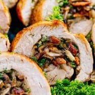 A juicy and easy Stuffed Pork Tenderloin loaded with mushrooms and bacon. This pork roulade looks fancy but it is an EASY and inexpensive way to feed a crowd. #porktenderloin #stuffedporktenderloin #porktenderloinroulade #pork #dinner