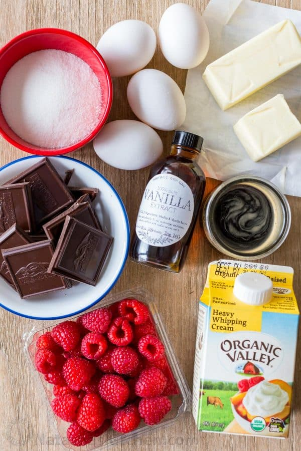 Ingredients for chocolate mousse with chocolate, raw eggs, raspberries, butter, coffee and whipping cream