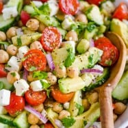Chickpea Salad loaded with crisp cucumbers, juicy tomatoes, creamy avocado, feta cheese and chickpeas or garbanzo beans. Fresh, healthy and protein packed! #chickpeasalad #garbanzobeansalad #chickpeas #chickpeasaladrecipe #salad #saladrecipe #fetacheese #tomatosalad #avocadosalad #greeksalad #mediterraneansalad #natashaskitchen