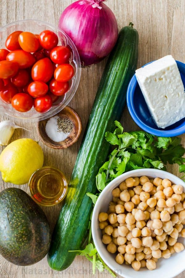 chickpea salad ingredients with healthy chickpeas, cucumber, tomato, avocado, cilantro and feta cheese