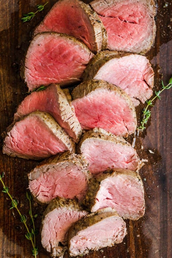 Roasted Beef Tenderloin Sliced into medallions on a cutting board