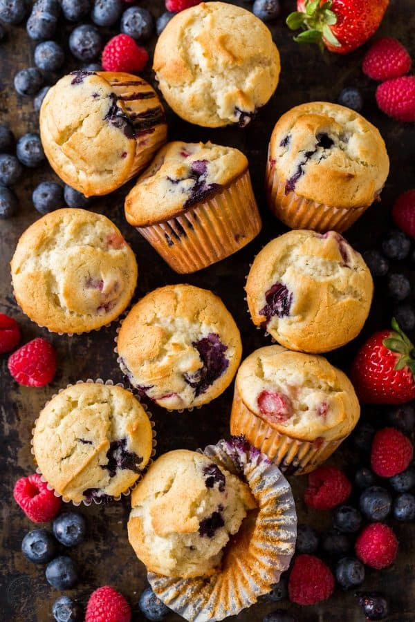 Mixed Berry Muffins surrounded by strawberries, raspberries and blueberries