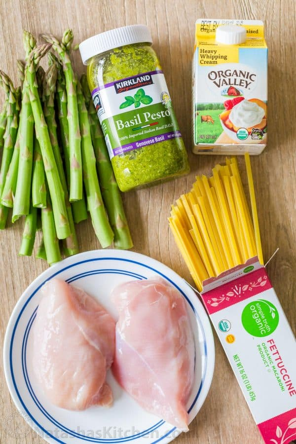 Chicken Pesto Pasta ingredients with basil pesto, asparagus, heavy whipping cream, fettuccine noodles and chicken breast