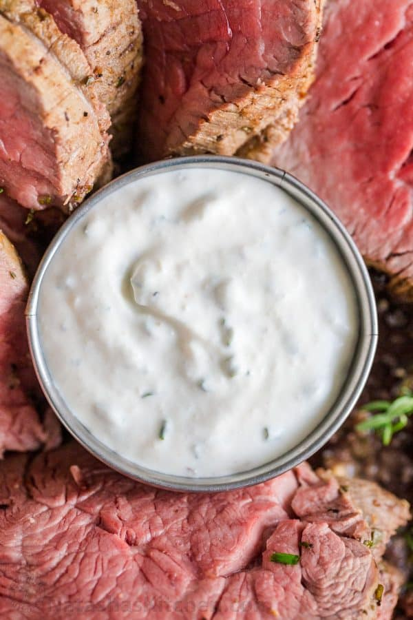 Horseradish sauce served in a ramekin with beef tenderloin