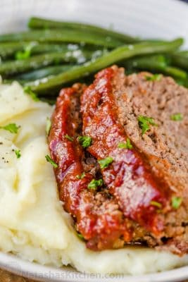 Amazing homemade Meatloaf Recipe. The meatloaf is so tender and juicy on the inside with a sweet and tangy sauce that glazes the meatloaf and adds so much flavor!