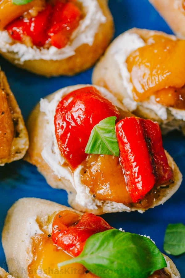Up close bruschetta with goat cheese and roasted peppers