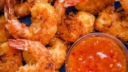 Coconut shrimp served with sweet chili sauce and lime wedges