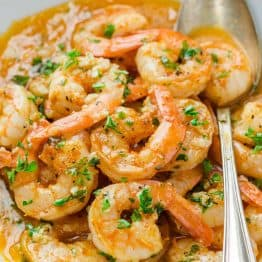Shrimp Scampi in a Bowl with Serving spoon