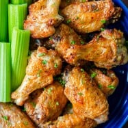 Air Fryer chicken wings in bowl with celery
