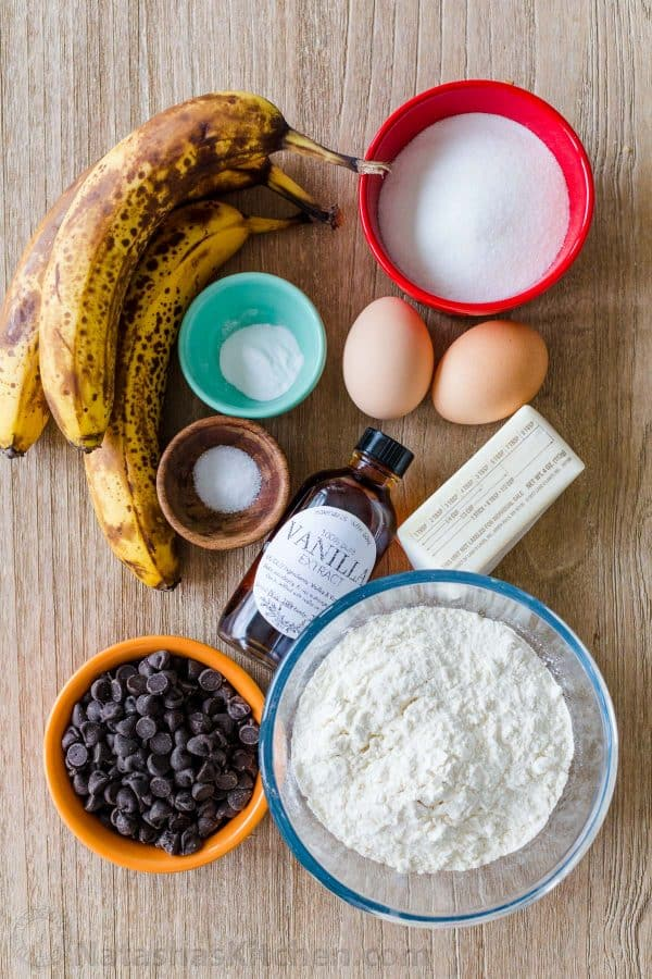 Ingredients for banana muffins with overripe bananas and chocolate chips