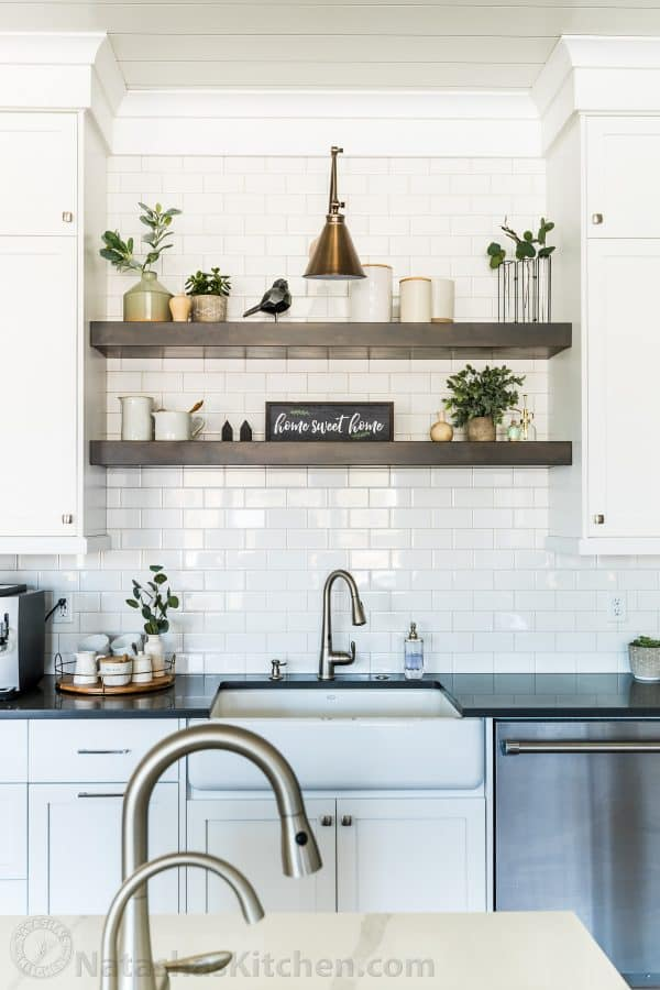 kitchen sink with decorated shelves
