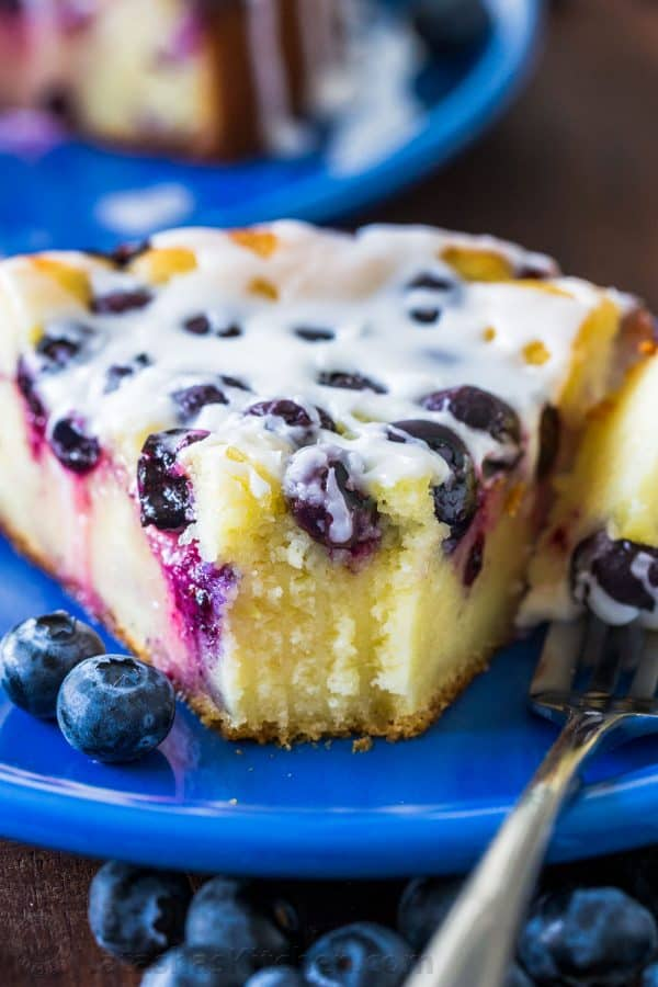 slice of blueberry ricotta cake on a blue plate with fork