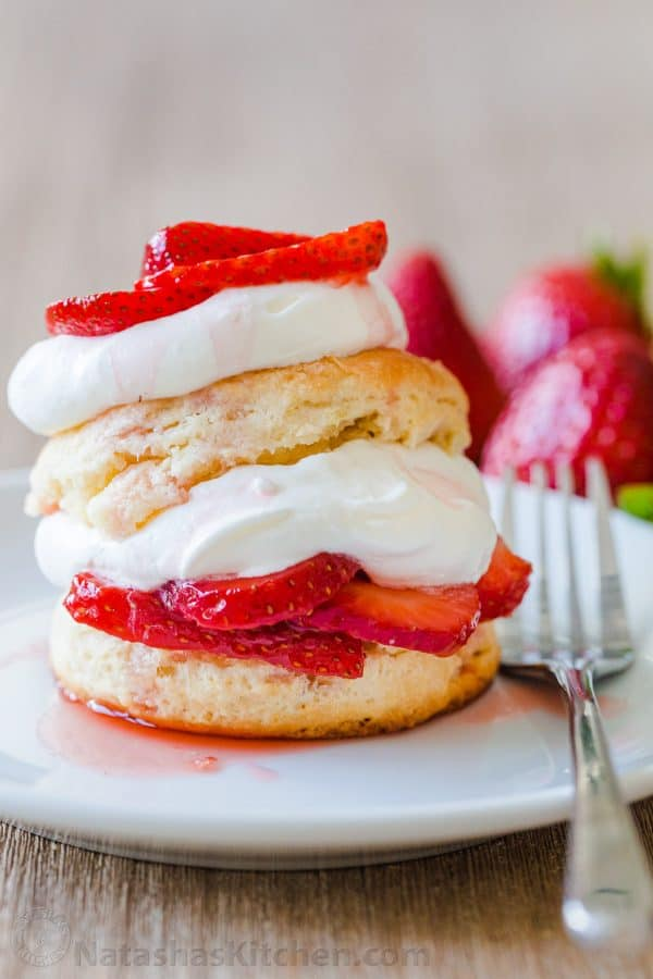 Strawberry Shortcake stacked on a plate with fork