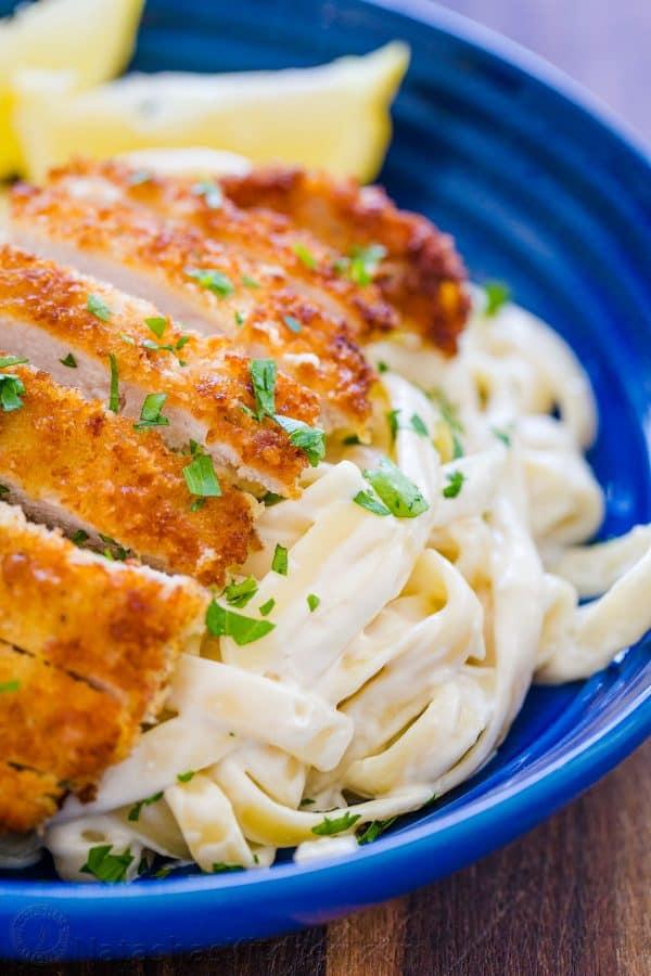 Warm lemon chicken pasta garnished with parsley