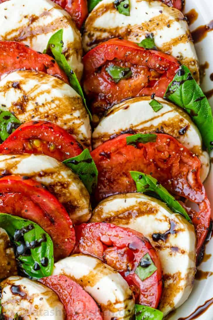 How to make a caprese salad in layers on a platter with balsamic reduction