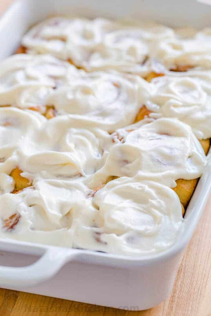 Easy cinnamon rolls baked and glazed in casserole dish