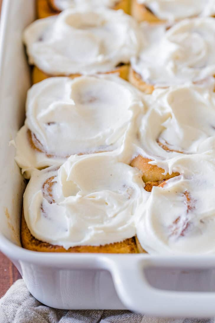 yeast dough cinnamon rolls glazed with icing in pan