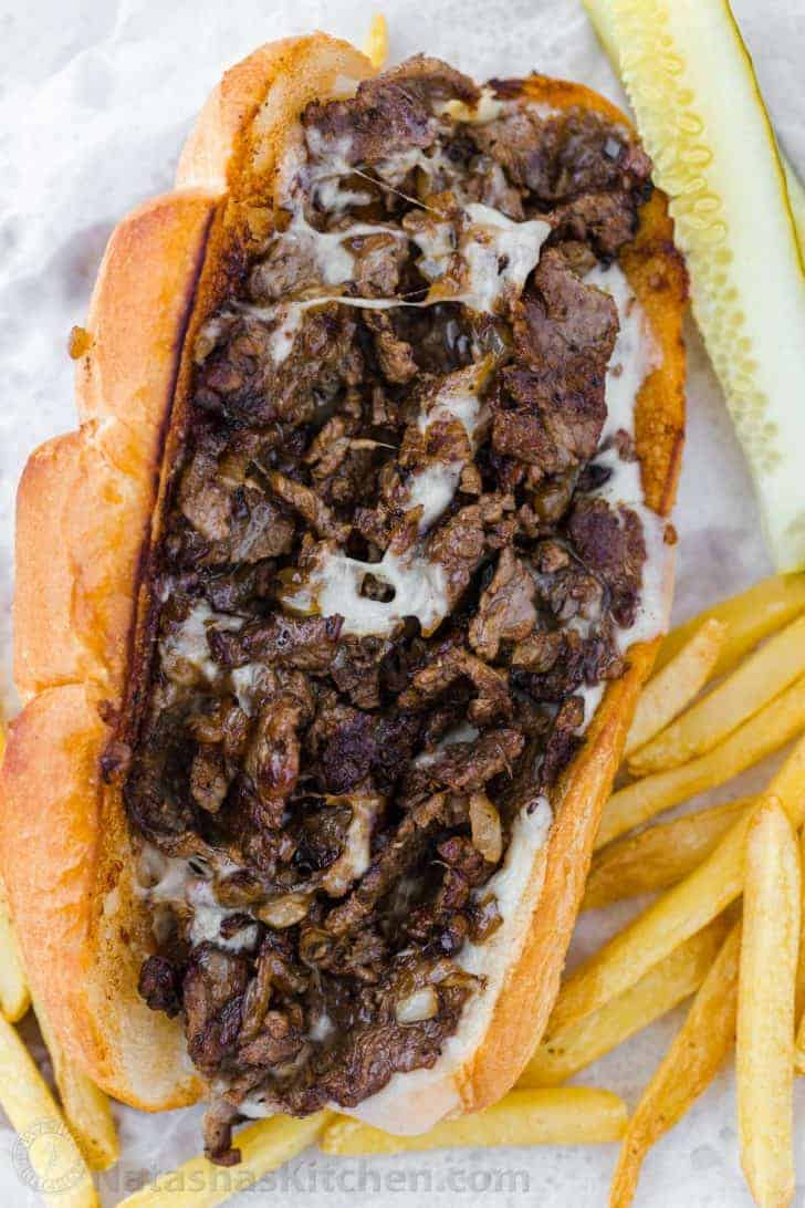 Philly cheesesteak sandwich with melted provolone cheese