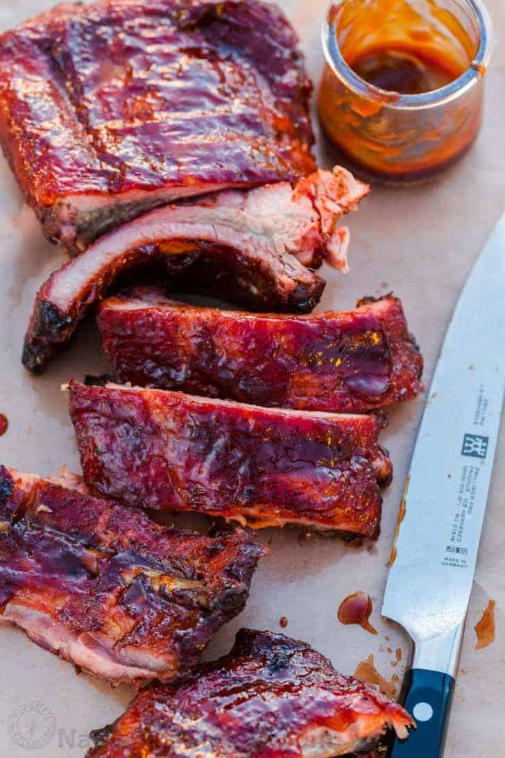 Sliced ribs served with BBQ Sauce