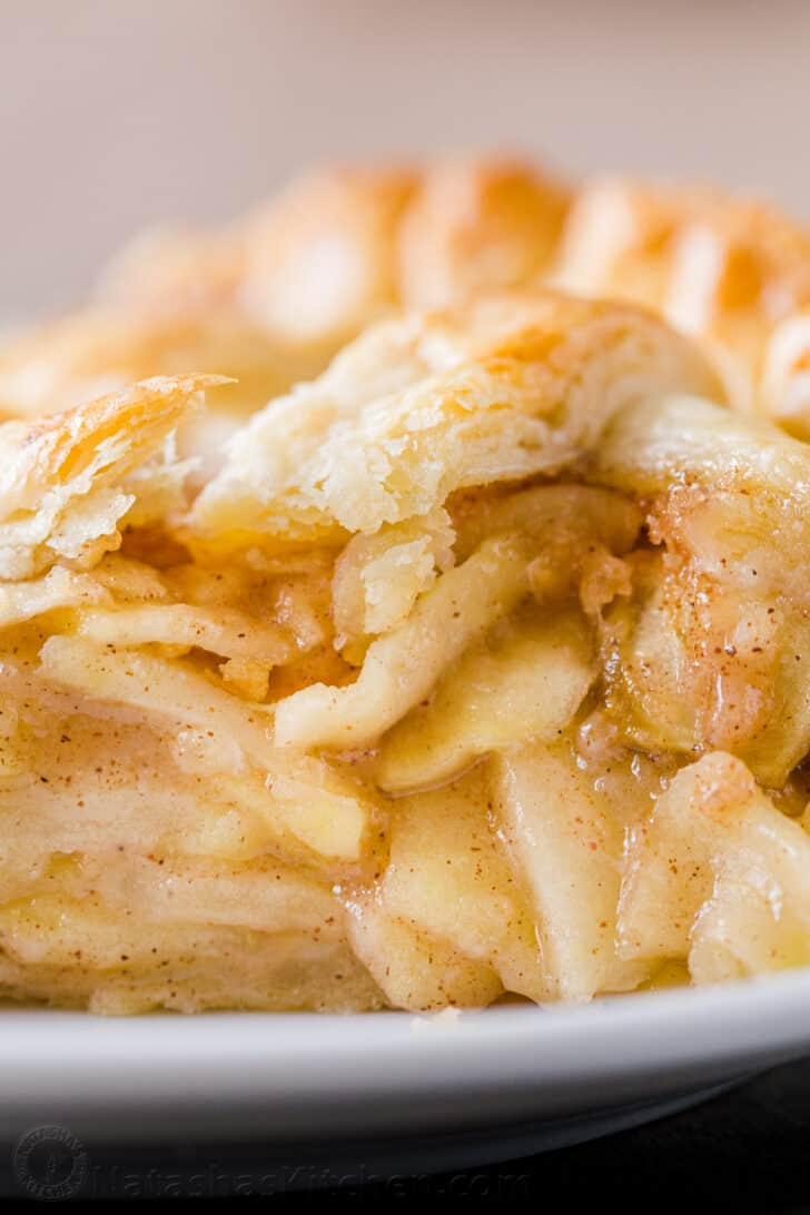 Baked granny smith apples in pie on a plate