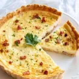 Quiche lorraine recipe on serving platter